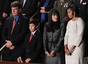 Michelle Obama went for subtle elegance with this long-sleeve white sheath dress during the State of the Union Address.