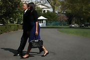 Michelle Obama paired black pointy flats with her sheath dress for a comfy yet stylish finish.