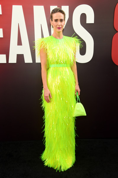 Sarah Paulson matched her dress with a neon-green satin pouch.