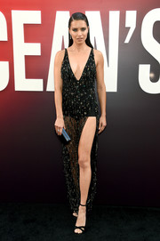 Adriana Lima finished off her look with black cross-strap sandals by Sophia Webster.