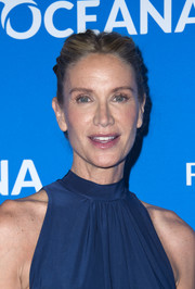 Kelly Lynch topped off her look with a center-parted, braided updo for the Oceana: Sting Under the Stars event.