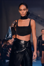Joan Smalls walked the Off-White runway clutching a mirrored blue tote.