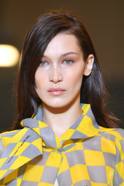 Bella Hadid looked lovely with her loose side-parted 'do at the Off-White Fall 2019 show.