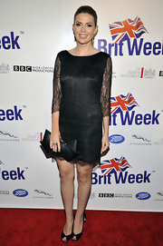 Carly Steel stepped into a pair of black peep toe pumps that showed off her perfect crimson pedicure for the launch of BritWeek 2012.