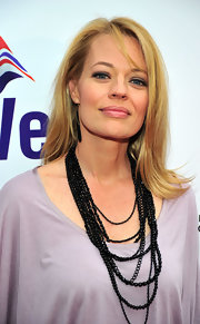 Jeri Ryan arrived for the official launch of BritWeek 2012 wearing her blond hair in sleek layers with long wispy bangs.