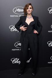 Clotilde Courau kept it low-key in a black pantsuit teamed with a matching corset top at the Trophee Chopard dinner.