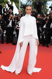 Josephine Skriver donned a white Ashi Studio turtleneck with an open back and a high-low hem for the 2019 Cannes Film Festival screening of 'Oh Mercy!'