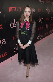Zoe Kazan paired her cute frock with gold ankle-strap pumps.