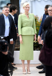 Tilda Swinton chose a lime-green peplum skirt suit by Haider Ackermann for the Cannes Film Festival photocall for 'Okja.'