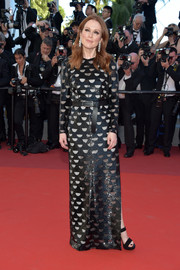 Julianne Moore went modern-glam in a black sequin peekaboo gown by Louis Vuitton for the Cannes Film Festival screening of 'Okja.'