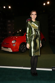 Olga Sorokina spiced up the classic trench coat with this metallic green version at the Fiat Brand party in LA.