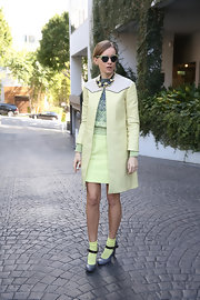 Olga Sorokina channeled '60s icon Twiggy with this neon yellow skirt suit and ombre sweater.