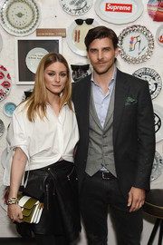 Olivia Palermo attended the Oliver Peoples pour Berluti launch carrying a boldly striped clutch.
