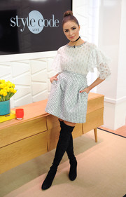 Olivia Culpo was demure up top in a white blouse with layered ruffle sleeves while appearing on Amazon's 'Style Code Live.'