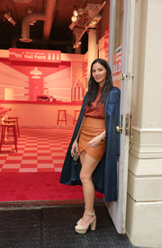 Olivia Munn arrived for the opening of Target Tribeca wearing a blue satin duster coat.
