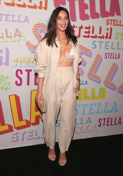 Olivia Munn Bra [stella mccartney,olivia munn,clothing,pantsuit,fashion,suit,red carpet,carpet,shoulder,fashion design,flooring,event,autumn 2018 collection launch,los angeles,california]