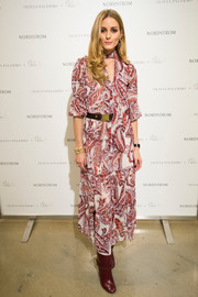 Olivia Palermo promoted her Chelsea28 collection wearing a paisley-print tie-neck dress from the line.