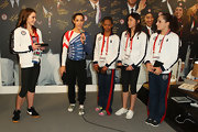 Kyla Ross visited the USA House wearing white canvas sneakers.