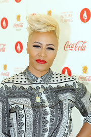 Emeli highlighted her perfect pout with a classic matte red lipstick.
