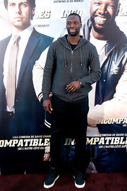 Omar Sy kept his red carpet look casual and comfy with this gray zip-up hoodie.