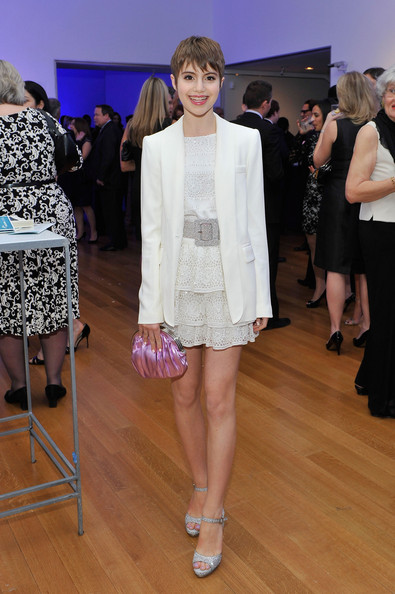 Sami Gayle accessorized with a metallic pink frame clutch for a dose of color.