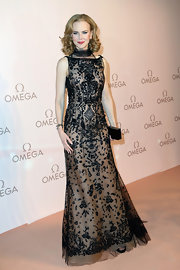 Nicole Kidman looked statuesque in this nude gown with black, embroidered lace overlay at the Omega Gala in Austria.
