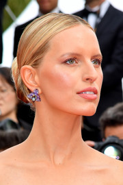 Karolina Kurkova opted for a classic center-parted bun when she attended the 2019 Cannes Film Festival screening of 'Once Upon a Time in Hollywood.'