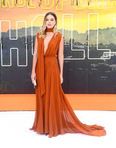 Margot Robbie looked ultra sophisticated in a burnt-orange Oscar de la Renta gown with a plunging neckline and choker detail at the UK premiere of 'Once Upon a Time in Hollywood.'