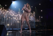 Jennifer Lopez dazzled in a fringed gold bodysuit at the 'One Voice: Somos Live!' concert.
