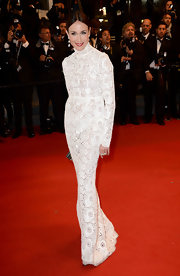 Elsa Zylberstein looked lovely as ever in this long-sleeve white lace gown.