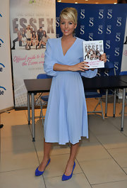 Lydia Rose Bright went for a classic look with a pleated pastel blue wrap dress.