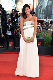 Sara Cavazza Facchini went for minimalist sophistication in a white and gold strapless gown during the Venice Film Festival opening ceremony.