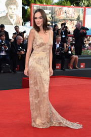 Emanuela Postacchini looked alluring in a beaded nude gown with a deep-V neckline during the Venice Film Festival opening ceremony.