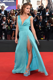 Giulia Electra Goretti flaunted some leg in a turquoise Grecian gown with a super-high slit during the Venice Film Festival opening ceremony.