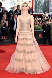 Sarah Gadon looked ethereal in a nude and gold Armani Prive gown during the Venice Film Festival opening ceremony.