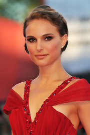 Natalie Portman paired showed off a sleek updo while hitting the Venice Film Festival.