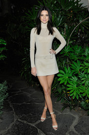 Kendall Jenner kept it minimalist-chic all the way down to her white ankle-strap sandals.