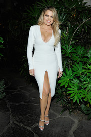 Khloe Kardashian put her assets on display in a low-cut, high-slit white sheath dress by Wes Gordon during the launch of the #mycalvins Denim Series.
