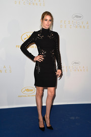 Doutzen Kroes was rocker-chic in a grommeted LBD during the Cannes opening ceremony dinner.