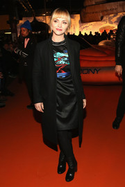 Christina Ricci arrived for the Opening Ceremony fashion show looking tough-chic in a black wool coat and a pair of boots.