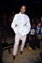 Kelly Rowland looked smart in a belted white shirt at the Opening Ceremony Spring 2019 show.