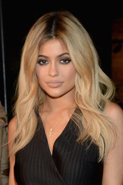 Kylie Jenner contrasted her heavy eye makeup with a nude lip.