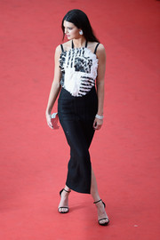 Kendall Jenner went for edgy elegance at the 'Grace of Monaco' premiere with this black-and-white Chanel cocktail dress featuring frayed detailing on the bodice.