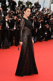 Gong Li walked the red carpet looking seductive in a sheer black Roberto Cavalli gown during the 'Grace of Monaco' premiere.