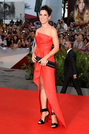 Sandra's structured red gown made a big and bold statement on the red carpet of the 'Gravity' premiere in Venice.