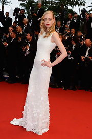 Tanya Dziahileva chose a long beaded gown for her soft and elegant red carpet look.