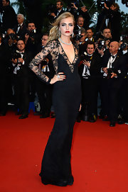 Cara Delevingne rocked the red carpet  when she wore this floor-length long-sleeve lace number.