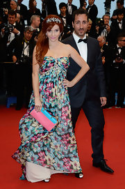Phoebe Price chose a boldly printed floral frock for her look a the Cannes Film Festival.
