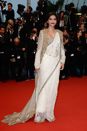 Sonam Kapoor stunned in a lace gown that featured intricate gold detailing all over.