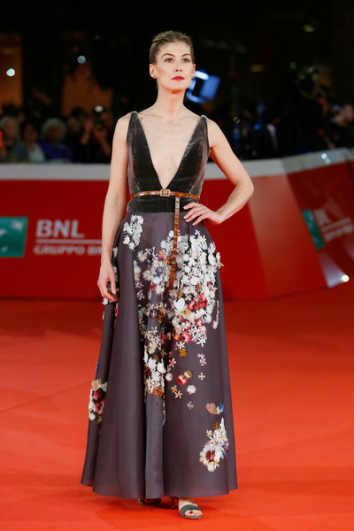 Rosamund Pike looked enchanting in a gray Christian Dior Couture gown with a floral-embroidered skirt at the Rome Film Fest premiere of 'Hostiles.'